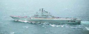 An aerial port beam view of the Soviet Kiev class aircraft carrier MINSK underway.