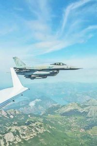 A Greek F-16D Flying Falcon intercepts a Montenegrin Learjet 45 during a simulated interception exercise. A year on from Montenegro joining the Alliance, NATO has started air policing over the country which does not have its own fighter jets.