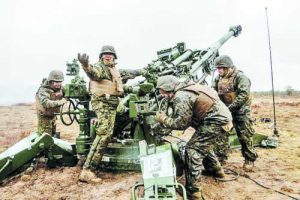 US Marines prepare to fire their M777 howitzer during Exercise Dynamic Front 2019 at Adazi Training Grounds in Latvia. The exercise lets NATO Allies practice receiving and executing artillery fire missions in unison.