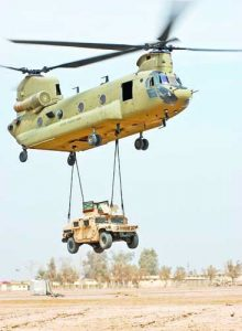 A CH-47F Chinook cargo helicopter from the 2nd Battalion, Combat Aviation Brigade, 4th Infantry Division, Multi-National Division - Baghdad, lifts a Humvee off the ground during a sling load certification training exercise at Camp Taji, March 6. The training was intended to provide Soldiers with the essential skills necessary for sling loading equipment and supplies with a Chinook, the U.S. Army's premiere heavy lift aircraft.