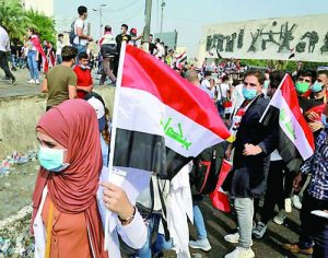 Students take part in anti-government protests in Baghdad, Iraq, Monday, Oct. 28, 2019. Protests have resumed in Iraq after a wave of demonstrations earlier this month were violently put down. (AP Photo/Hadi Mizban)