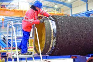 Поставяне на външното покритие на тръба за подводен газопровод
