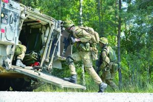 Royal Danish soldiers conduct an infantry training exercise at the 7th Army Joint Multinational Training Command's training area in Grafenwoehr, Germany, July 3, 2014.  (U.S. Army photo by Gertrud Zach/Released)