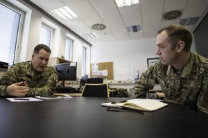 U.S. Air Force Master Sgt. Daniel Williams, 435th Contingency Response Support Squadron air advisor flight chief, left, and Capt. Daniel McKeown, 435th CRSS assistant director of operations, conduct a virtual meeting from Ramstein Air Base, Germany, with Bulgarian air force personnel assigned to the force protection team at Graf Ignatievo Air Base, Bulgaria, May 19, 2020. In preparation for the arrival of the Bulgarian air force's F-16 fleet, the Bulgarian force protection team at Graf Ignatievo Air Base wanted to find ways to utilize their manning that maximizes security for their base and allocates time for essential training. The air advisors provided potential courses of action, enabling the team to achieve their goals while sustaining the new assets when they arrive. (U.S. Air Force photo by Staff Sgt. Devin Boyer)