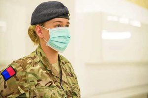 Image shows military personnel assisting at the NHS Nightingale Hospital in Harrogate, North Yorkshire. This week the military will undertake two large scale medical deployments to the NHS Nightingale facilities in Harrogate and Bristol as part of its response in the battle against coronavirus.    75 Combat Medic Technicians will embed at the NHS site in Harrogate as skilled clinical support workers. They will support healthcare professionals, who make up the majority of the workforce, with basic patient care and monitoring. The Harrogate facility was formally opened today by fundraising veteran Captain Tom Moore.    At the Bristol facility 60 Combat Medical Technicians will join the NHS and volunteer workforce.  Alongside this, a further 100 personnel will be deployed to Harrogate and a further 60 personnel to Bristol to assist with general duties such as porterage, equipment maintenance, stores management and distribution. Both sites will be supported by specialist military medical control teams to help coordinate the effort.  Members of the Armed Forces have been involved with both Nightingale sites from the initial recces and have been assisting the NHS build the facilities at scale and pace with logistical and planning expertise. The medical personnel have been undergoing training with the NHS and have already begun embedding at the Harrogate site. The Nightingale hospitals have been set up around the country as part of a massive NHS effort to respond to the greatest global health emergency in more than a century. This extra capacity is on top of the 33,000 additional beds freed up across NHS hospitals – the equivalent of building 50 district general hospitals – and the up to 8,000 beds put at the NHS' disposal through an unprecedented deal with the independent sector.