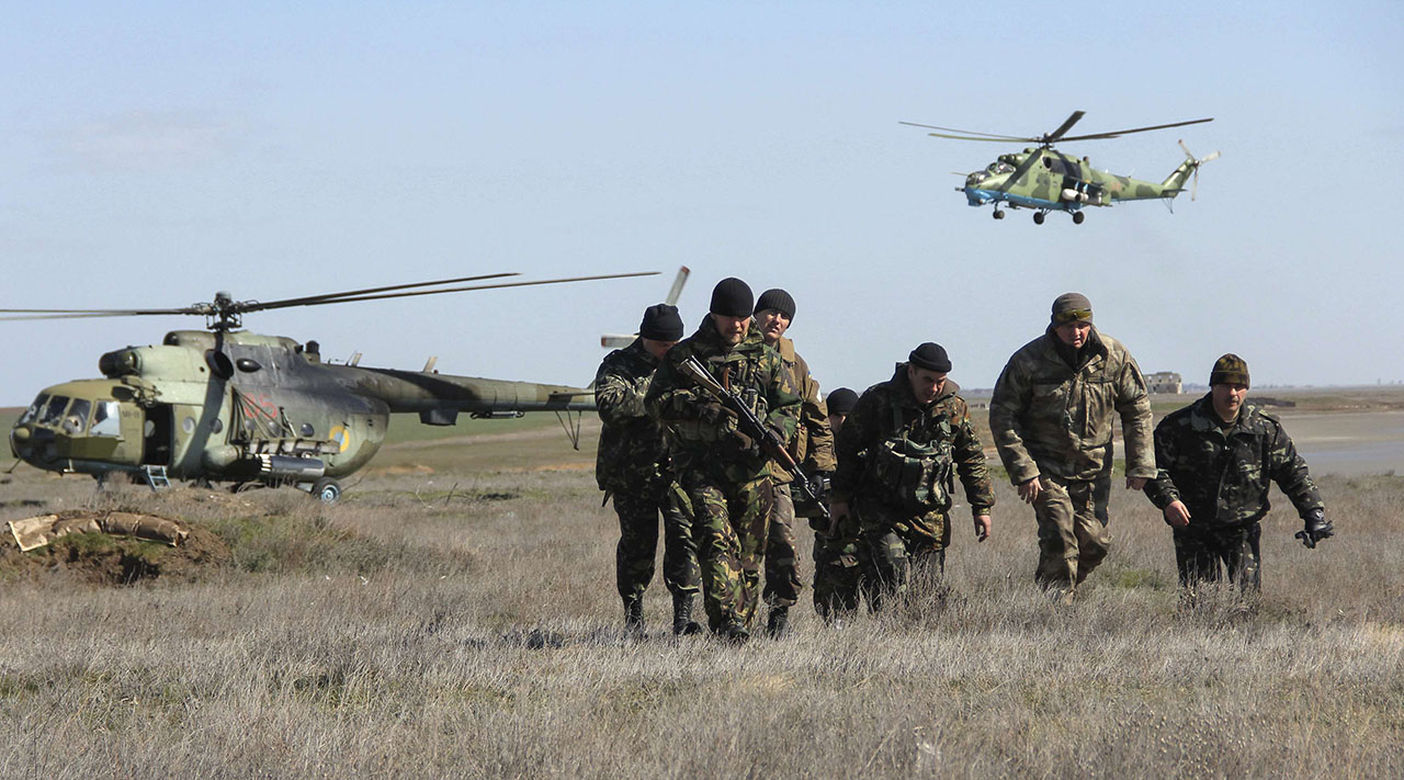 Ukrainian soldiers and military helicopters are seen near the village of Salkovo, in Kherson region adjacent to Crimea