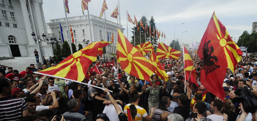 Protesters wave Macedonian and Albanian flags during an anti-government demonstration in front of the government building in Skopje