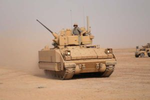 Bradley Fighting Vehicle drives off range. CONTINGENCY OPERATING BASE SPEICHER, Iraq – Infantrymen from 1st Battalion, 5th Cavalry Regiment, 2nd Advise and Assist Brigade, 1st Cavalry Division, drive their M2A3 Bradley Fighting Vehicle off of Memorial Range after zeroing the 25mm main gun and M240B machine gun during a live fire exercise in support of Operation New Dawn near Contingency Operating Base Speicher, Iraq, July 29, 2011. (U.S. Army photo by Sgt. Quentin Johnson, 2nd AAB PAO, 1st Cav. Div., USD – N)