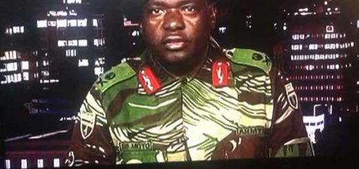 """This screen grab taken early on November 15, 2017 from a television broadcast on the Zimbabwe Broadcasting corporation (ZBC) shows Zimbabwe Major General Sibusiso Moyo reading a statement at the ZBC broadcast studio in Harare. Zimbabwe's military appeared to be in control of the country on November 15 as generals denied staging a coup but used state television to vow to target """"criminals"""" close to President Robert Mugabe. / AFP PHOTO / Dewa MAVHINGA        (Photo credit should read DEWA MAVHINGA/AFP/Getty Images)"""