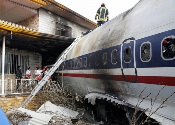 Boeing 707 cargo plane that crashed while landing at Fath airport, near the city of Karaj, Alborz province, Iran, 14 January 2019. According to media reports, at least seven members of the crew have been killed in the accident. One person has reportedly survived, media added.Ê  EPA/HASSAN SHIRAVANI