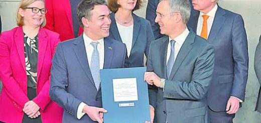 NATO Secretary General Jens Stoltenberg and the Foreign Minister of the invitee country, Nikola Dimitrov with the Accession Protocol