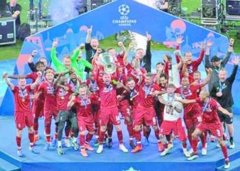 Liverpool's Jordan Henderson lifts the trophy after winning the Champions League final soccer match between Tottenham Hotspur and Liverpool at the Wanda Metropolitano Stadium in Madrid, Saturday, June 1, 2019. (AP Photo/Emilio Morenatti)
