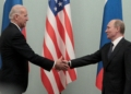 FILE PHOTO: Russian Prime Minister Vladimir Putin (R) shakes hands with U.S. Vice President Joe Biden during their meeting in Moscow March 10, 2011. REUTERS/Alexander Natruskin/File Photo